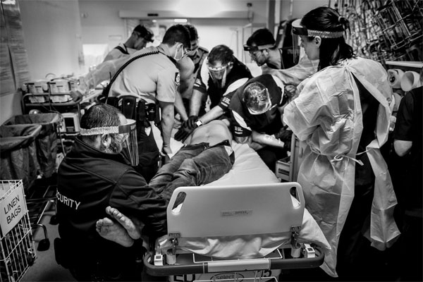 This photo captures 'Bill', a young man in the throes of an ice-induced medical emergency. It took nine hospital staff, including full-time security personnel, to restrain the man before he could be treated by a medical crew. Source: Gary Ramage/Walkeys.com