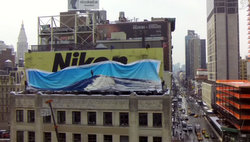 Apple's promo video shows an iPhone photo covering a Nikon billboard.