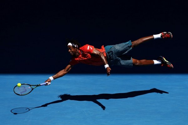 Gael Monfils of France dives for a forehand at the Australian Open in Melbourne. Photo Cameron Spencer. Source: Walkley.