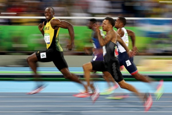 Say Cheese. Usain Bolt of Jamaica competes in the Men's 100 meter semifinal on Day 9 of the Rio 2016 Olympic Games in Brazil. Photo: Cameron Spencer. Source: Walkley.